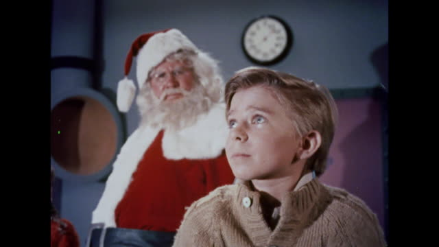 1964 a martian traps santa and two children in an airlock chamber - science fiction film stock videos & royalty-free footage