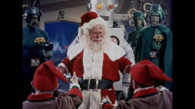 1964 martians attempt to kidnap santa claus from his workshop - エルフ点の映像素材/bロール