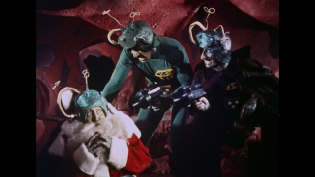 1964 martians threaten a santa claus decoy - science fiction film stock videos & royalty-free footage