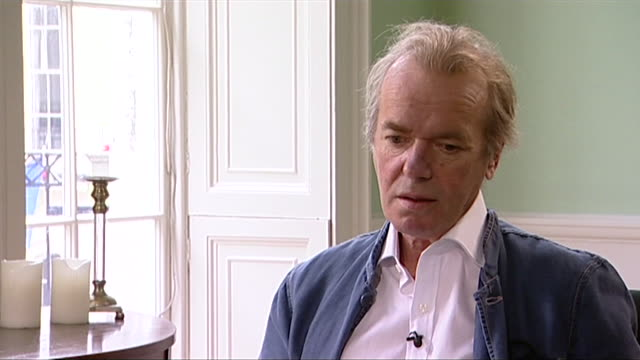 martin amis reflects on the plot of his novel 'lionel asbo' - imagination stock videos & royalty-free footage