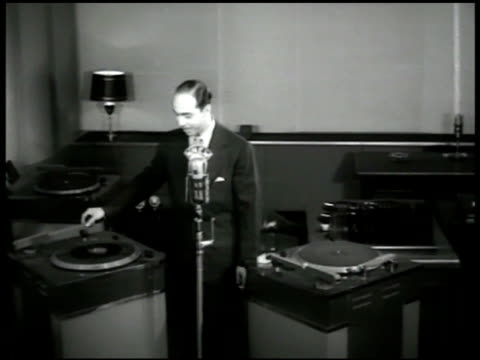vídeos de stock e filmes b-roll de martin block w/ phonograph machines amp microphone reprisal vs block 'we go to stage 2 for the sweetest music guy lombardo amp the royal canadians '... - 1947