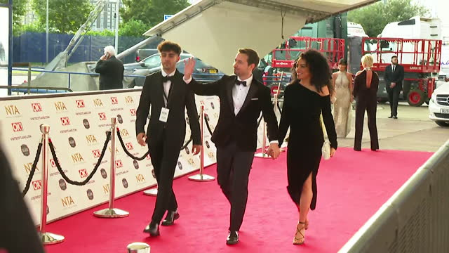 """martin compston and wife tianna chanel flynn, walk down red carpet together at nta awards 2021 - """"bbc news"""" stock videos & royalty-free footage"""