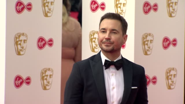 martin compston poses for photos on red carpet at bafta tv awards 2019 at royal festival hall london - british academy television awards stock videos & royalty-free footage