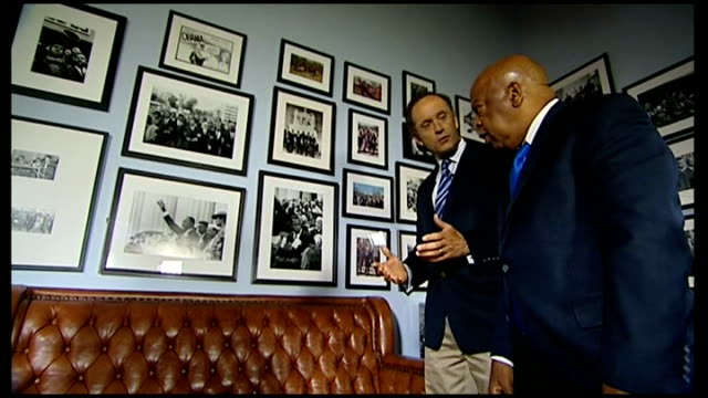 martin luther king i have a dream speech 50th anniversary congressman john lewis interview congressman john lewis and reporter looking at framed... - 1963 march on washington stock videos and b-roll footage