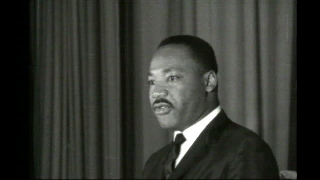 martin luther king iii speaks out on racial injustice in the usa; tx 7.12.1964 england: london: int b/w slow motion martin luther king making speech - martin luther king stock videos & royalty-free footage