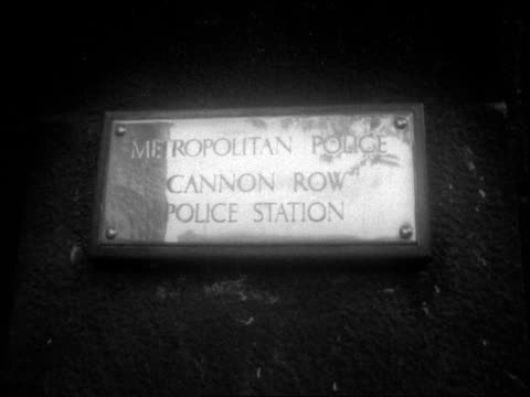 a england london cannon row cannon row front of police station [where james earl ray held] cu plaque words to that effect ms side policeman in... - front doorway stock videos & royalty-free footage