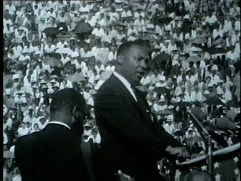"martin luther king jr. speaks to crowd at the illinois ""i have a dream"" civil rights rally in soldier field on june 21, 1964. no audio. - separation stock videos & royalty-free footage"