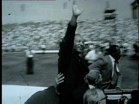 vídeos de stock, filmes e b-roll de wgn martin luther king jr waves to crowd gathered in soldier field for the 1964 the illinois i have a dream civil rights rally on june 21 1964 - 1964