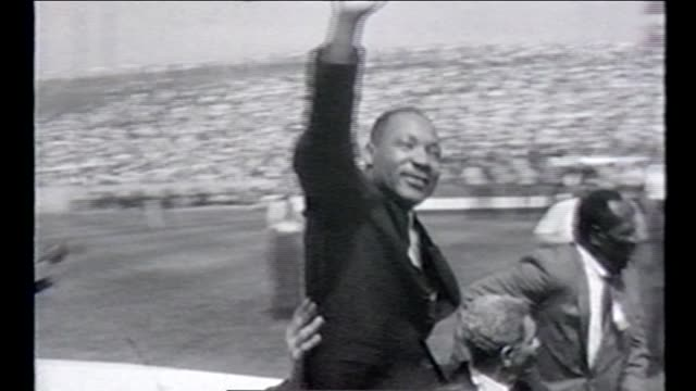 martin luther king jr waves to thousands gathered for the illinois 'i have a dream' civil rights rally at soldier field on june 21 1964 - martin luther king stock videos and b-roll footage