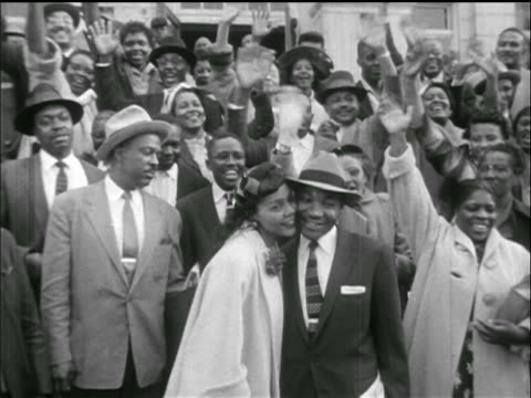 martin luther king jr wife embracing for camera / supporters behind / montgomery al - martin luther religious leader stock videos & royalty-free footage