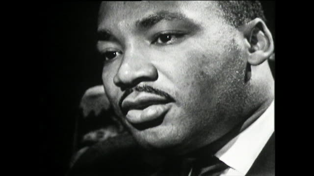 "martin luther king on his experience of police brutality and the ku klux klan in his childhood; 1961. ""...i remember as a child seeing problems of... - black civil rights stock videos & royalty-free footage"