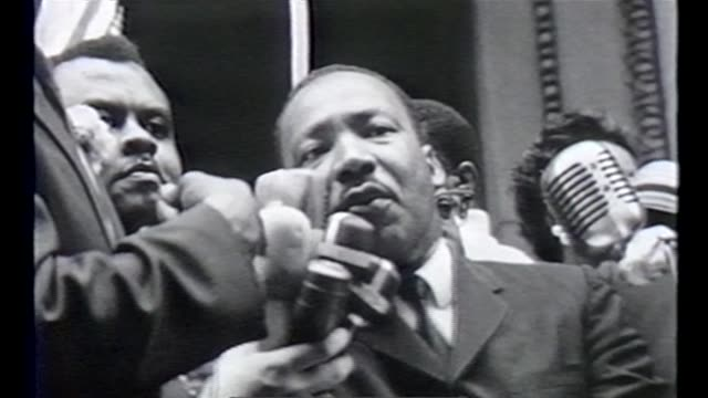 wgn martin luther king speaks to civil rights marchers filling the streets of downtown chicago on july 26 1965 - housing difficulties stock videos & royalty-free footage