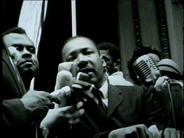 martin luther king speaks to civil rights marchers filling the streets of downtown chicago on july 26, 1965. - 1965 stock videos & royalty-free footage
