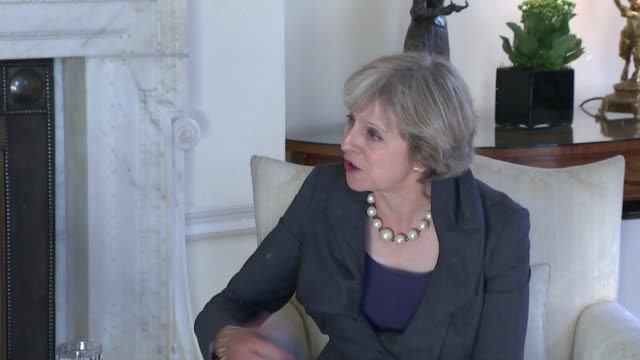 london downing street int theresa may mp and martin schulz along and seated for photocall theresa may mp statement sot re period of time before... - article stock videos & royalty-free footage