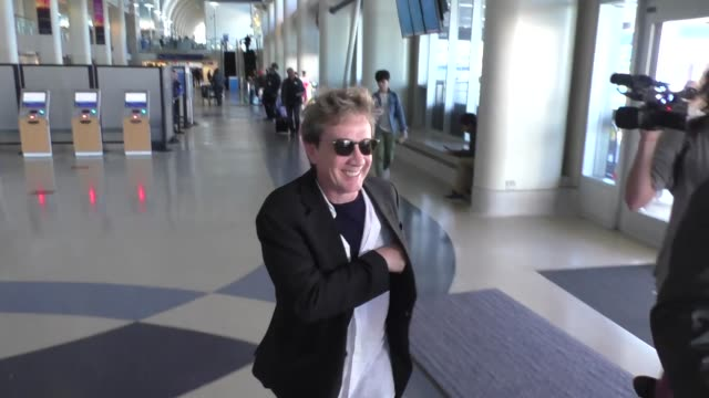 martin short talks about looking like barry manilow while departing at lax airport in los angeles in celebrity sightings in los angeles, - martin short stock videos & royalty-free footage