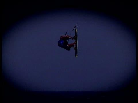martin vari and female rider perform stunts and tricks on kite boards fuerteventura canary islands spain - eskapismus stock-videos und b-roll-filmmaterial
