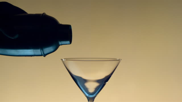 ms, td, slo mo, martini being poured out of shaker - martini stock videos & royalty-free footage