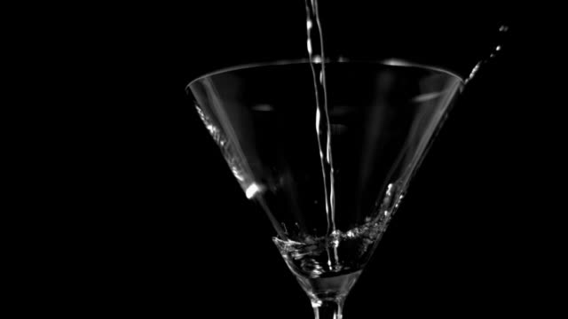 martini glass in super slow motion being filled - martini stock videos & royalty-free footage