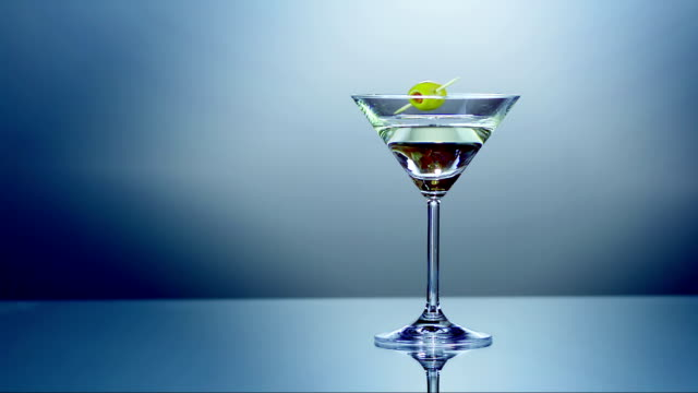 martini with olive (super slow motion) - martini stock videos & royalty-free footage