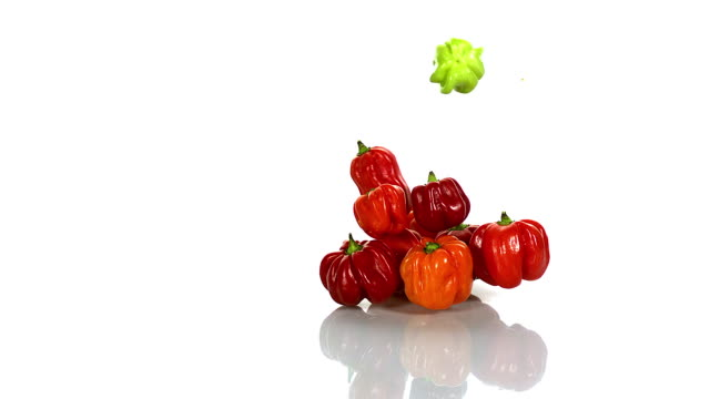 martinique hot pepper, capsicum annuum falling against with background, slow motion - オレンジピーマン点の映像素材/bロール