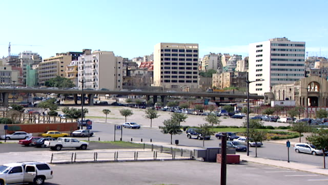 martyrs' square pan from fouad chehab avenue to the war ravaged dome city center aka the egg which was the biggest cinema in lebanon in the late 1950s - main road stock videos & royalty-free footage