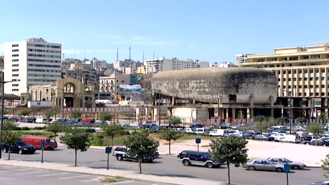 martyrs' square view of the war ravaged dome city center aka the egg which was the biggest cinema in lebanon in the late 1950s - main road stock videos & royalty-free footage