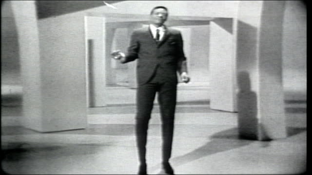 "vídeos de stock e filmes b-roll de marvin gaye performs ""ain't that peculiar"" with the hullabaloo dancers. - television show"