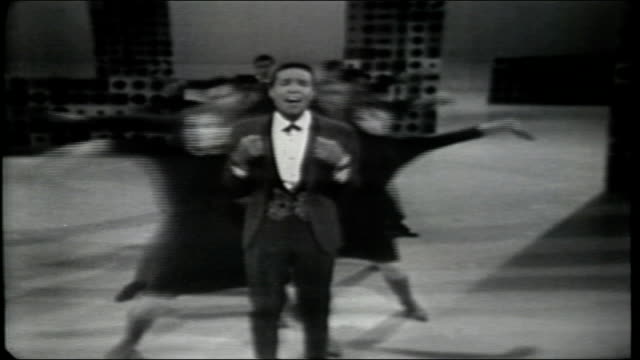 "vídeos de stock e filmes b-roll de marvin gaye performs ""how sweet it is"" , accompanied by the hullabaloo dancers. - television show"