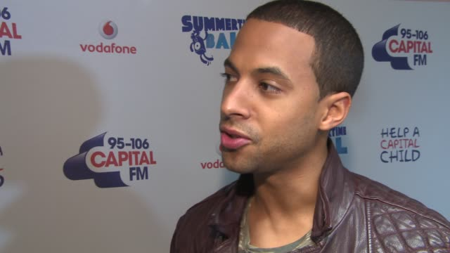 vídeos de stock, filmes e b-roll de marvin humes on jls breaking up, djing for wembley and on simon cowell at the capital summertime ball 2013 in london, uk - 2013
