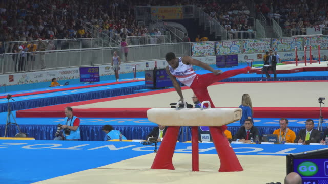 marvin kimble at the pommel horse. the 2015 pan american games, officially the xvii pan american games, were a major international multi-sport event... - all around competition stock videos & royalty-free footage