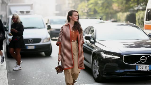 Mary Leest wearing a brown jacket with cropped sleeves and beige high waist pants is seen during Milan Fashion Week Spring/Summer 2019 on September...