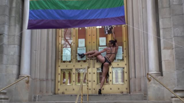 mary magdeline' twerks in front of an lgbtq flag outside marble collegiate church during the 29th annual dyke march celebrating lgbtq pride on june... - azul stock videos & royalty-free footage