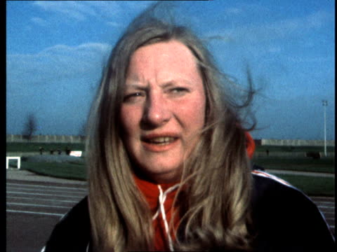 mary peters takes part in first athletics meeting since death of her coach; england: london: plaistow: macmillan stadium: mary signs autograph mary... - メアリー ピータース点の映像素材/bロール