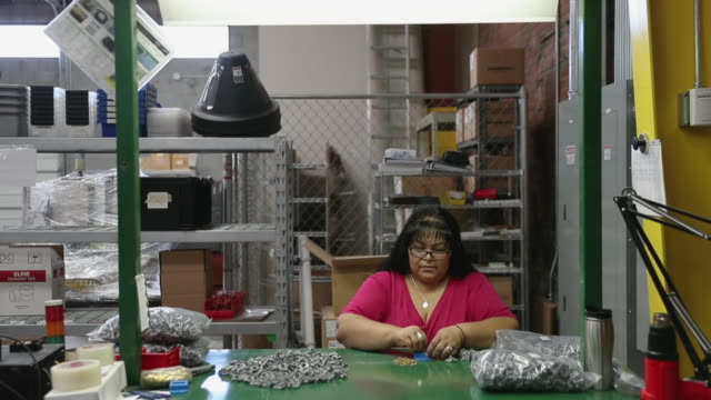 mary rios assembles switches at the cesarscott el paso facility on june 04 2019 in el paso texas once assembled the switches are then shipped to the... - joe pass stock videos and b-roll footage