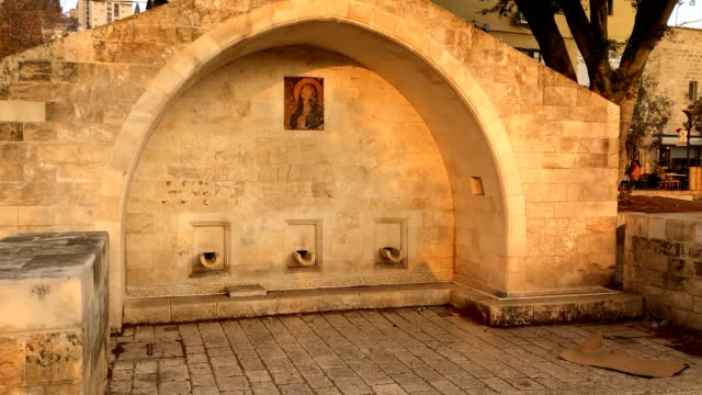 mary's well in nazareth at sunset. this is said to be the location of the annunciation mentioned in the new testament. - 新約聖書点の映像素材/bロール