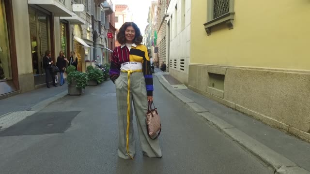 stockvideo's en b-roll-footage met marzia bellotti wearing casadei shoes zara pants vintage belt palm angels top and vintage louis vuitton bag is seen during milan fashion week... - louis vuitton modelabel