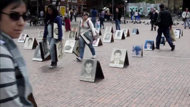 mas de 15000 desaparecidos en colombia en los ultimos 30 anos según naciones unidas voiced no olvidar a los desaparecidos on august 30 2012 in bogota... - naciones unidas stock videos & royalty-free footage