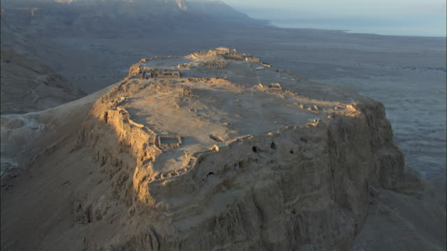 aerial masada at sunrise, judea desert, israel - fortress stock videos and b-roll footage