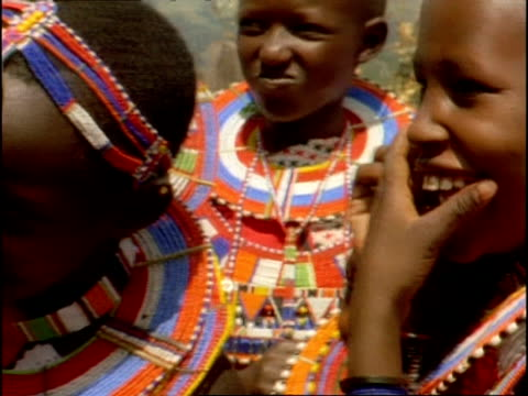 mcu masai children wearing colourful beads, laughing, kenya - perlenschnur stock-videos und b-roll-filmmaterial