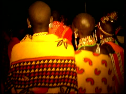 Masai jumping, dancing, singing at night, CU, Kenya (sound available)