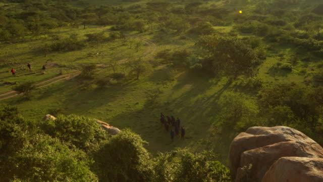 Masai tribesmen seen from a high rock