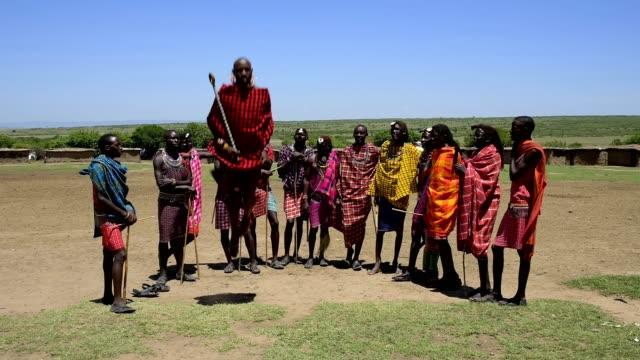 masai warriors dancing, masai mara national reserve, kenya, africa - masai stock videos and b-roll footage