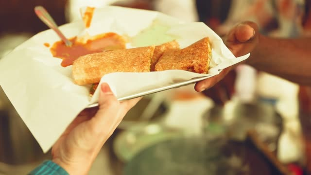 masala dosa being served to the customer - giving stock videos & royalty-free footage