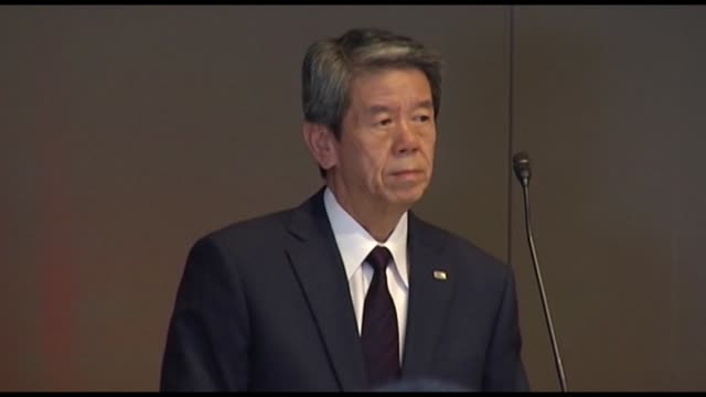 Masashi Muromachi incoming chairman president and chief executive officer of Toshiba Corp left Hisao Tanaka outgoing president and chief executive...