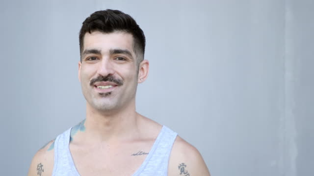 masculine latino man with tattoos and mustache - moustache stock videos & royalty-free footage