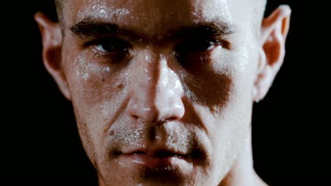 slo mo masculine man covered in sweat - super slow motion stock videos & royalty-free footage