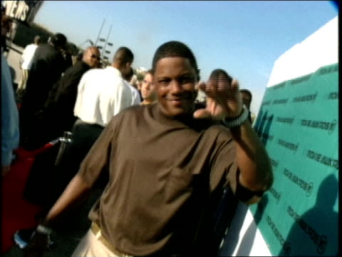 Mase on the red carpet at the 1998 MTV Movie Awards he is saying hi to Carson Daly and complimenting his girlfriend Jennifer Love Hewitt