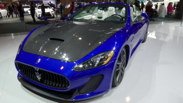 maserati exhibit at chicago auto show / xws ha left side of exhibit / xws ha front end of convertible / ws front end / ws ha seats / ms rear seats /... - motor show stock videos and b-roll footage