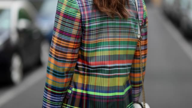 vídeos de stock e filmes b-roll de masha sedgwick is seen wearing checked multi colored blazer dries van noten green silk topshop midi skirt miu miu high plateau sandals white round... - sandália