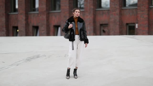 Masha Sedgwick is seen wearing orange brown Topshop knit white cropped Joseph pants Topshop boots with snake print Longchamp shearling jacket Celine...